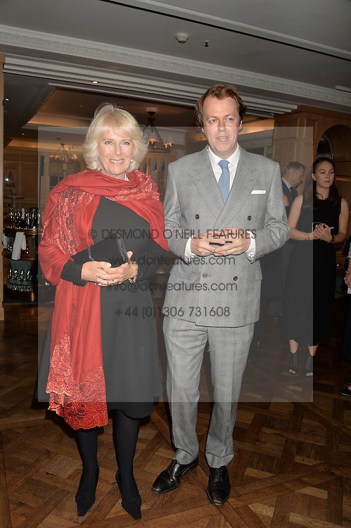 The DUCHESS OF CORNWALL and her son TOM PARKER BOWLES at a party hosted by Ewan Venters CEO of Fortnum & Mason to celebrate the launch of The Cook Book by Tom Parker Bowles held at Fortnum & Mason, 181 Piccadilly, London on 18th October 2016.
