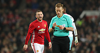Football - 2016 / 2017 League [EFL] Cup - Quarter-Final: Manchester United vs. West Ham United<br /> <br /> Wayne Rooney of Manchester United complains to referee Mike Jones after he is booked during the match  at Old Trafford.<br /> <br /> COLORSPORT/LYNNE CAMERON