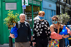 © Licensed to London News Pictures. 05/07/2020. LONDON, UK.  A family of plant lovers visits Columbia Road Flower Market in East London on the its reopening after certain coronavirus pandemic lockdown restrictions were relaxed by the UK government.  Photo credit: Stephen Chung/LNP