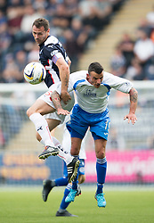 Falkirk's David McCracken with Queen of the South's Derek Lyle.<br /> Falkirk 1 v 1 Queen of the South, Scottish Championship game played today at The Falkirk Stadium.