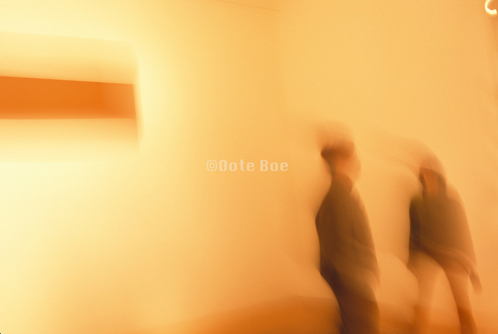 blurry people in a gallery