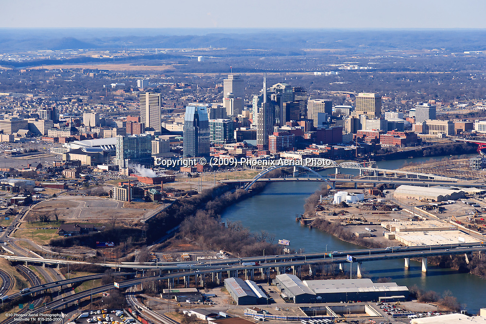 Aerial photo of Downtown Nashville Skyline and the Cumberland River showing an industrial area in the foreground.