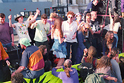 Ravers dancing on top of a truck at the First Criminal Justice March. Trafalgar Square, London, UK, 1st of May 1994.