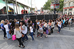 Hundreds of One Direction fans queueing in Leicester Square in London for the world premiere of the band's film One Direction: This Is Us,Tuesday, 20th August 2013. Picture by Stephen Lock / i-Images