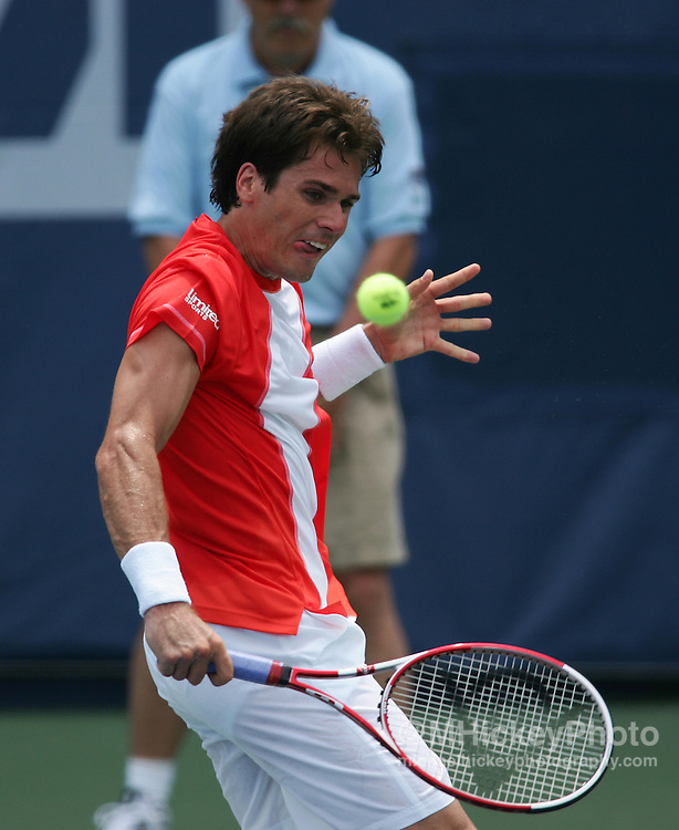 Tommy Haas returns returns the ball during match play against George Bastl at the RCA Championships in Indianapolis July 19, 2006.