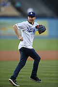 LOS ANGELES, CA - AUGUST 22:  Actor  Jesse Tyler Ferguson, co-star of the comedy television series Modern Family, jogs out to the pitcher's mound to throw out the celebratory first pitch before the Los Angeles Dodgers game against the New York Mets at Dodger Stadium on Friday, August 22, 2014 in Los Angeles, California. The Dodgers won the game 6-2. (Photo by Paul Spinelli/MLB Photos via Getty Images) *** Local Caption *** Jesse Tyler Ferguson