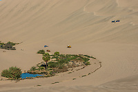 tourists with dune buggies in the peruvian coast at Ica Peru
