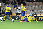 Maidenhead United midfielder Ben Wright tackles Port Vale forward Byron Moore during the The FA Cup match between Port Vale and Maidenhead United at Vale Park, Burslem, England on 8 November 2015. Photo by Jemma Phillips.