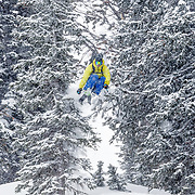 Forrest Jillson airing through the trees during a winter storm.