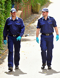&copy; Licensed to London News Pictures. 08/08/2018<br /> Deptford, UK. Police search team searching an area opposite a property where 7 year Joel Urhie was killed in a suspicious house fire at Adolphus Street, Deptford.  <br /> Photo credit: Grant Falvey/LNP
