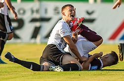 Andrija Bubnjar of Mura hit by Gašper Udovič of Triglav during football match between NK Triglav and NS Mura in 5th Round of Prva liga Telekom Slovenije 2019/20, on August 10, 2019 in Sports park, Kranj, Slovenia. Photo by Vid Ponikvar / Sportida