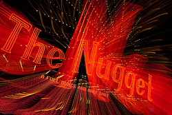 """""""The Nugget""""  This Nugget sign was photographed in Downtown Reno, Nevada. The effect was obtained in camera by long exposure mixed with intentional camera movement."""