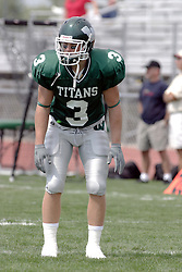 09 September 2006  Titan All American Eric Esch.In the first ever football competition between the Olivet Comets and the Illinois Wesleyan Titans, the Titans strut off the field with a 21- 6 victory. .Game action took place at Wilder Field on the campus of Illinois Wesleyan University in Bloomington Illinois.