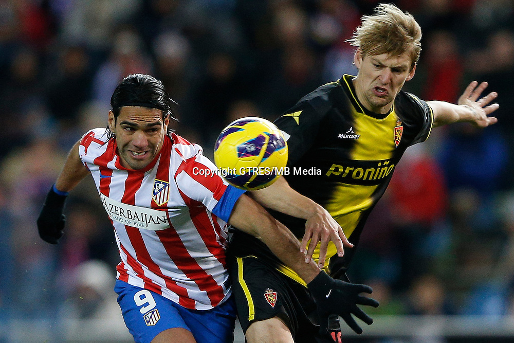 13.01.2013 SPAIN -  La Liga 12/13 Matchday 19th  match played between Atletico de Madrid vs Real Zaragoza (2-0) at Vicente Calderon stadium. The picture show  Radamel Falcao Garcia (Colombian striker of At. Madrid) and Ruben Micael Freitas Ressurreicao (Portuguese midfielder of Real Zaragoza)
