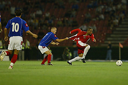 BELGRADE, SERBIA & MONTENEGRO - Wednesday, August 20, 2003: Wales' Daniel Gabbidon has his shirt pulled by Serbia & Montenegro's Zvonimir Vukic during the UEFA European Championship qualifying match at the Red Star Stadium. (Pic by David Rawcliffe/Propaganda)