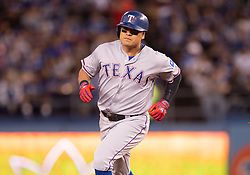 June 12, 2018 - Los Angeles, CA, U.S. - LOS ANGELES, CA - JUNE 12: Texas Rangers right fielder Shin-Soo Choo (17) rounds the bases after hitting a home run during the game between the Texas Rangers and the Los Angeles Dodgers on June 12, 2018, at Dodger Stadium in Los Angeles, CA. (Photo by David Dennis/Icon Sportswire) (Credit Image: © David Dennis/Icon SMI via ZUMA Press)