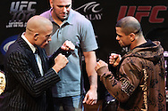 LAS VEGAS, NEVADA, JULY 9, 2009: UFC welterweight champion Georges St. Pierre (left) and challenger Thiago Alves face off during the pre-fight press conference for UFC 100 inside the House of Blues in Las Vegas, Nevada