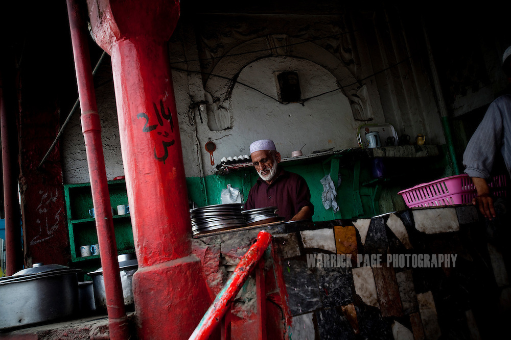 ABBOTTABAD, PAKISTAN - MAY 9: A cook in a tea house waits for customers on May 9, 2011 in Abbottabad, Pakistan. The town of Abbottabad became infamous after the US launched a midnight raid on a compound housing Osama bin Laden in the garrison town, on May 2, 2011. The operation, code-named Operation Neptune Spear, was launched from neighbouring Afghanistan and resulted in the killing of one of the world's most notorious terrorists and who claimed responsibility for the 9/11 attacks in the US. U.S. forces took bin Laden's body to Afghanistan for identification, then dumped it the Arabian Sea. The Pakistani military has since been widely suspected as having prior knowledge of his whereabouts as the compound was less than a kilometre from the country's biggest military academy.  (Photo by Warrick Page)