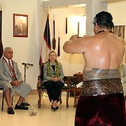American Samoa Governor, Togiola Tulafono looks on as US Secretary of State Hillary Clinton is served Kava during a traditional welcoming ceremony at Tafuna International Airport, Tutuila, American Samoa.  11/7/10, Photo by Barry Markowitz