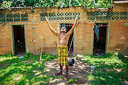 29 OCTOBER 2012 - MAYO, PATTANI, THAILAND: A resident prays at the Bukit Kong home in Mayo, Pattani. He said he is a survivor of the Tak Bai incident in which the Thai army killed more than 80 people protesting against the government. He said he didn't remember his name or how he came to be at the home. The home opened 27 years ago as a ponoh school, or traditional Islamic school, in the Mayo district of Pattani. Shortly after it opened, people asked the headmaster to look after individuals with mental illness. The headmaster took them in and soon the school was a home for the mentally ill. Thailand has limited mental health facilities and most are in Bangkok, more than 1,100 kilometers (650 miles) away. The founder died suddenly in 2006 and now his widow, Nuriah Jeteh, struggles to keep the home open. Facilities are crude by western standards but the people who live here have nowhere else to go. Some were brought here by family, others dropped off by the military or police. The home relies on donations and gets no official government support, although soldiers occasionally drop off food. Now there are only six patients, three of whom are kept chained in their rooms.  Jeteh says she relies on traditional Muslim prayers, holy water and herbal medicines to treat the residents. Western style drugs are not available and they don't have a medic on staff.     PHOTO BY JACK KURTZ