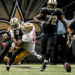 Nov 9, 2014; New Orleans, LA, USA; San Francisco 49ers outside linebacker Ahmad Brooks (55) sacks and forces a fumble by New Orleans Saints quarterback Drew Brees (9) during overtime of a game at Mercedes-Benz Superdome. The 49ers defeated the Saints 27-24 in overtime. Mandatory Credit: Derick E. Hingle-USA TODAY Sports