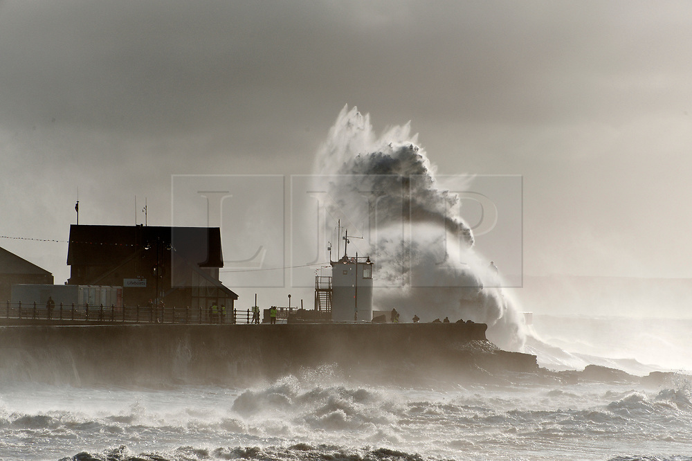 © Licensed to London News Pictures. 02/11/2019. Porthcawl, Bridgend, Wales, UK. Massive waves crash against the harbour wall as gale force winds and rain lash the seaside resort of Porthcawl in Bridgend, UK. Photo credit: Graham M. Lawrence/LNP