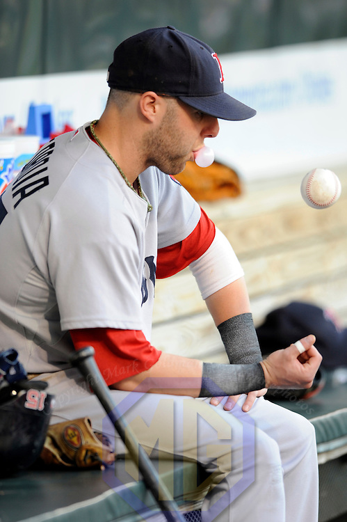 29 June 2009:  Boston Red Sox second baseman Dustin Pedroia (15) blows a bubble and tosses a ball in the dugout prior to the game against the Baltimore Orioles at Camden Yards in Baltimore, MD.  The Red Sox defeated the Orioles 4-0.  ****For Editorial Use Only****