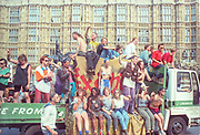 Ravers cheering from their truck outside Parliament Buildings Westminster. 2nd Criminal Justice March, London, UK, 23rd of July 1994.