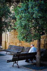 Old man sitting in the square in Adahuesca, Huesca, Aragon, Spain<br /> <br /> (c) Andrew Wilson | Edinburgh Elite media