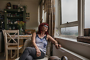 London, England, UK, May 31 2018 - Housing activist Aysen Dennis in her flat of Aylesbury Estate,  a housing estate in Walworth, South East London. <br /> Aylesbury  estate, once the largest estate in Europe, is currently undergoing a major regeneration programme by demolishing and replacing of the dwellings with modern houses controlled by a housing association. Some residents and activists including Ms Dennis still protest against the demolition and the gentrification of London.<br /> London is facing a major housing crisis, due to rising cost and under-supply.