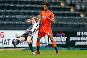 Notts County forward Jonathan Stead (30) plays the ball around Wycombe Wanderers defender Sido Jombati (2)  during the EFL Sky Bet League 2 match between Notts County and Wycombe Wanderers at Meadow Lane, Nottingham, England on 30 March 2018. Picture by Simon Davies.