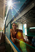 A Buddhist monk waiting for the train to leave the station, Central Railway Station, Yangon, Myanmar