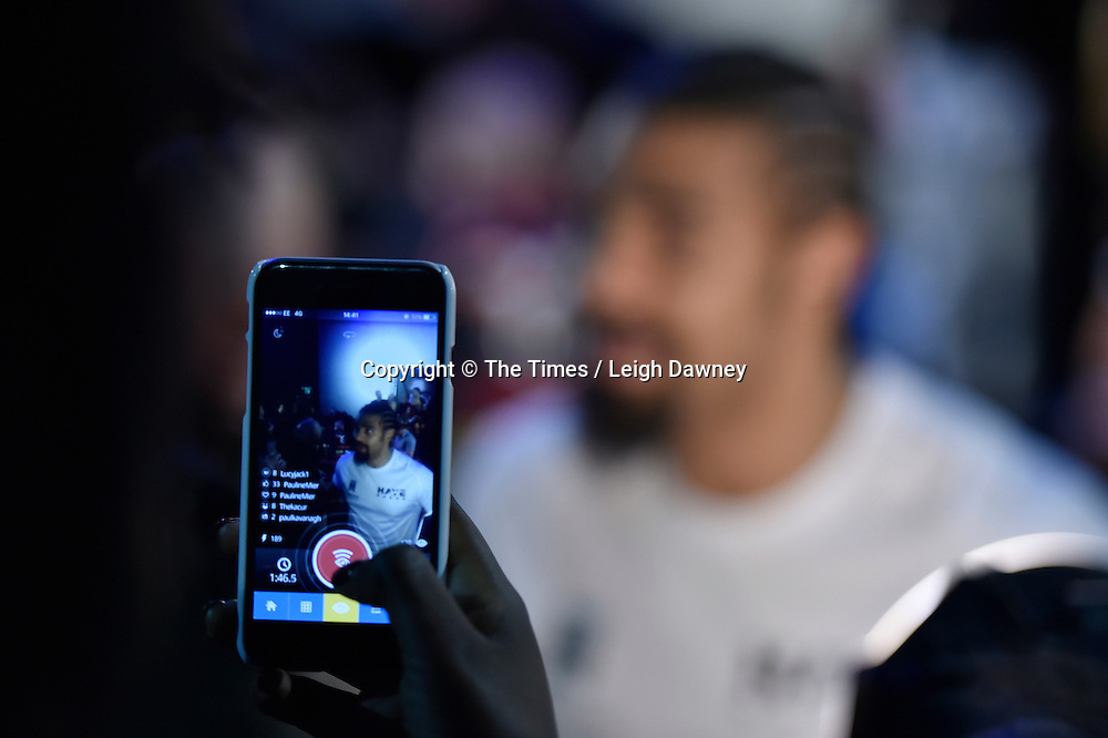 A spectator takes a photo of David Haye on their mobile phone during  the official weigh in ahead of his fight against Mark de Mori. The O2, London. 15th January 2016. Credit: Times Photographer Leigh Dawney