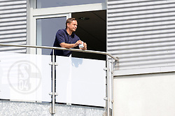 16.07.2013, Trainingsgelaende, Veltins Arena, GER, 1. FBL, FC Schalke 04 Training, im Bild Manager Horst Heldt ( Schalke 04/ Portrait ) beobachtet das Training entspannt von seinem Balkon aus mit einer Tasse Kaffee in der Hand. // during a Training Session of German Bundesliga Club Fc Schalke 04 at the Training Ground, Veltins Arena, Germany on 2013/07/16. EXPA Pictures © 2013, PhotoCredit: EXPA/ Eibner/ Thomas Thienel<br /> <br /> ***** ATTENTION - OUT OF GER *****