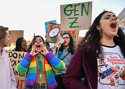 © Licensed to London News Pictures 15/02/2019 London, UK. Lucy Sutton (18) (Left) from Brampton College encourages protesters to hold their ground. At the close of a long day of protest, students who took the day off school to protest inaction over climate change move from Parliament Square to Westminster Bridge and stage a sit-down blocking traffic at rush hour. Photo credit: Guilhem Baker/LNP
