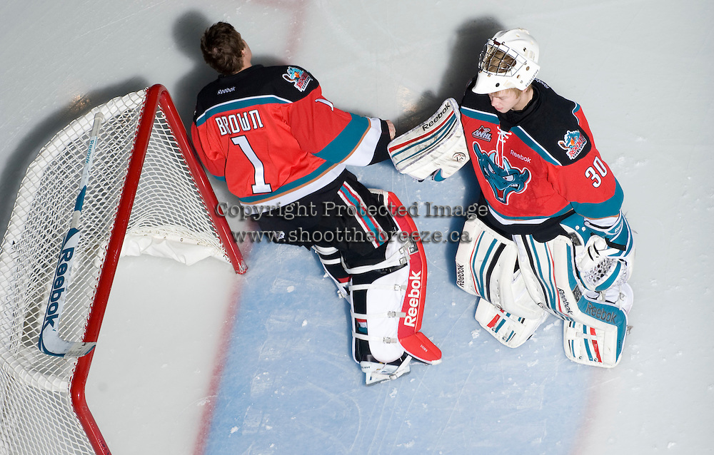 KELOWNA, CANADA, DECEMBER 2: Jordon Cooke #30 and Adam Brown #1 of the Kelowna Rockets take part in a pre-game ritual as the Victoria Royals visit the Kelowna Rockets  on December 2, 2011 at Prospera Place in Kelowna, British Columbia, Canada (Photo by Marissa Baecker/Shoot the Breeze) *** Local Caption ***