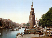 View of Oude Schans (New Canal), Amsterdam, Holland, 1890-1900.  The Montelbaanstoren, built in 1512, housed the city's military guard and is part of Amsterdam's old defences. Netherlands Transport Water Trade Quay Architecture