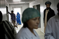 Women in Afghanistan. People crowd the halls of the hospital in mazar e Sharif. Female surgeon Dr. Sawia looks tired. -But I'm happy to have a job, she says. Being a woman and a doctor in Afghanistan is not common and the salary is not high. Dr. Sawia makes only 50 usd/month, a lot less comparing to her male colleagues..