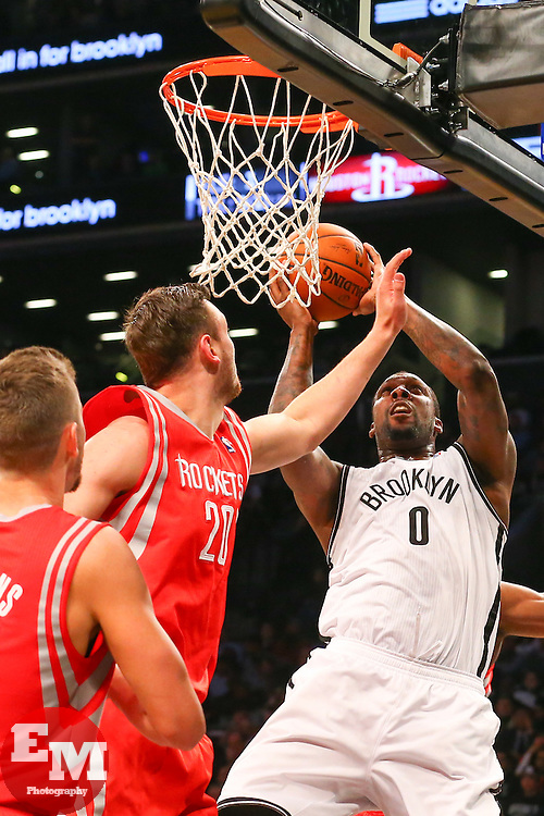 Apr 1, 2014; Brooklyn, NY, USA; Brooklyn Nets center Andray Blatche (0) shoots the ball while being defended by Houston Rockets forward Donatas Motiejunas (20) during the fourth quarter at Barclays Center. The Nets defeated the Rockets 105-96.