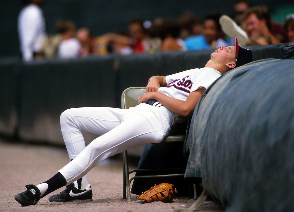 CHICAGO, IL - 1986:  A batboy takes a short nap between innings of a game at old Comiskey Park in Chicago, Illinois.  Old Comiskey Park was demolished in 1991.  (Photo by Ron Vesely)