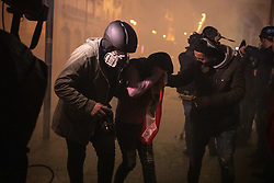 "© Licensed to London News Pictures. 22/01/2020. Beirut, Lebanon. Media help an injured demonstrator during riots outside government buildings on the streets of Beirut following the announcement late last night that a government has been formed. Police respond with tear gas and water cannon against the anti-government demonstrators. Violence has been escalating in the capital following a ""week of wrath"", where demonstrators were campaigning against government corruption and economic crisis. Photo credit : Tom Nicholson/LNP"