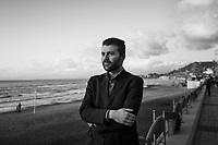AGROPOLI (SA) - 4 FEBBRAIO 2018: Carmine Parisi (28), ex militante del PD cacciato dal Partito Democratico per aver denunciato le speculazioni edilizie nella zona del cilento e aver posto interrogativi sull'ex sindaco di Agropoli Franco Alfieri, ora candidato alla Camera dei Deputati nel collegio uninominale di Agropoli (Campania), è qui in posa per un ritratto ad Agropoli (SA) il 4 febbraio 2018.<br /> <br /> Le elezioni politiche italiane del 2018 per il rinnovo dei due rami del Parlamento – il Senato della Repubblica e la Camera dei deputati – si terranno domenica 4 marzo 2018. Si voterà per l'elezione dei 630 deputati e dei 315 senatori elettivi della XVIII legislatura. Il voto sarà regolamentato dalla legge elettorale italiana del 2017, soprannominata Rosatellum bis, che troverà la sua prima applicazione<br /> <br /> ###<br /> <br /> AGROPOLI, ITALY - 4 FEBRUARY 2018: Carmine Parisi (28), former activist of the Democratic Party (PD / Partito Democratico) expelled from the party after denouncing the urban speculation in the Cilento region and questioning the actions of Franco Alfieri - former mayor of Agropoli and chief of staff of the governor of the Campania region Vincenzo De Luca, now running for a seat in the Chamber of Deputies in the 2018 Italian General Elections - poses for a portrait in Agropoli, Italy, on February 4th 2018.<br /> <br /> The 2018 Italian general election is due to be held on 4 March 2018 after the Italian Parliament was dissolved by President Sergio Mattarella on 28 December 2017.<br /> Voters will elect the 630 members of the Chamber of Deputies and the 315 elective members of the Senate of the Republic for the 18th legislature of the Republic of Italy, since 1948.