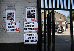 © Licensed to London News Pictures. 20/06/2017. London, UK. Posters adorn the wall outside the Finsbury muslim welfare centre where worshippers were targeted in north London after a van ploughed into a crowd nearby. One person has been killed and 10 people are injured. Darren Osborne, 47, from Cardiff, continues to be held on suspicion of attempted murder and alleged terror offences.  Photo credit: Peter Macdiarmid/LNP
