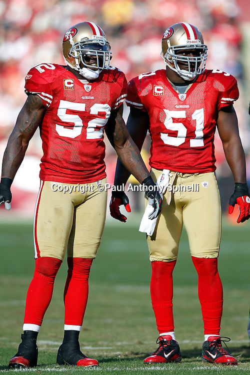 San Francisco 49ers linebacker Patrick Willis (52) and San Francisco 49ers linebacker Takeo Spikes (51) look on during a break in the action at the NFL week 11 football game against the Tampa Bay Buccaneers on Sunday, November 21, 2010 in San Francisco, California. The Bucs won the game 21-0. (©Paul Anthony Spinelli)