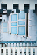 Blue shutters on a house in Tanjung Kumbik, Indonesia.