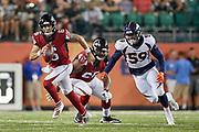 Atlanta Falcons quarterback Kurt Benkert (6) runs away form Denver Broncos linebacker Malik Reed (59) during the Pro Football Hall of Fame Game at Tom Benson Hall of Fame Stadium, Thursday, Aug. 1, 2019, in Canton, OH. The Broncos defeated the Falcons 14-10. (Robin Alam/Image of Sport)