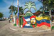 A street corner in Jaimanitas, a community on the northwestern edge of Havana, Cuba. Today, this community is known as Fusterlandia, and is the home, studio and artistic dream of artist José Rodriguez Fuster, who has decorated over 80 houses with ornate murals and domes to suit the personality of his neighbors. Fuster has also built a chess park with giant boards and tables, The Artists' Wall composed of a quilt of dozens of tiles signed and donated by other Cuban artists, a theatre and public swimming pools.