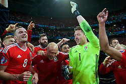 LILLE, FRANCE - Friday, July 1, 2016: Wales' Andy King, Joe Ledley, David Cotterill, Neil Taylor and goalkeeper Wayne Hennessey celebrate in the team huddle after the 3-1 victory over Belgium during the UEFA Euro 2016 Championship Quarter-Final match at the Stade Pierre Mauroy. (Pic by David Rawcliffe/Propaganda)