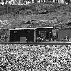 Travel a few minutes down the road from the post office and you will find a small house with a few work shacks next to the tracks. In this part of Appalachia traditional work buildings are more common than new apartment complexes and shopping centers.