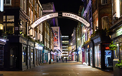 © Licensed to London News Pictures. 20/03/2020. London, UK. Carnaby Street at 8.30pm. The West End was left unprecedentedly empty on Friday night following the government's announcement that all bars, pubs and restaurants must be closed immediately in the latest step to curb the coronavirus outbreak.  Photo credit: Guilhem Baker/LNP